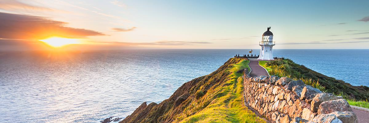 Looking across Cape Reinga lighthouse towards the sunset