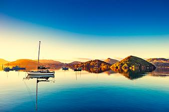 Yachts moored at sunset in Port Chalmers on the Otago Peninsula